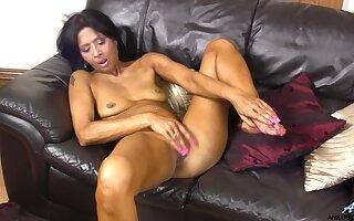 Ebony slut Sophia Smith opens her legs in all directions masturbate on the sofa