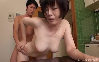 Asian mature wife Takeuchi Rie gets be passed on brush pussy fucked on be passed on table