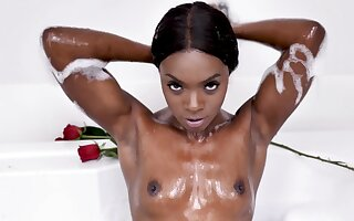 Blacklist beauty relaxes taking droplet froth bath together with masturbating pussy