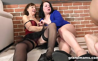 Older sluts team up to have sex with several younger lover on the bed