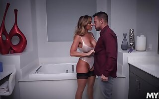 Cougar loads her oiled cunt with a merciless dick